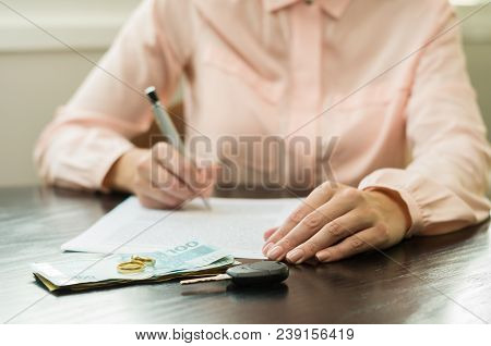 Great Concept Of Divorce, End Of Relationship, Young Woman Signing Divorce Agreement. Money, Car Key