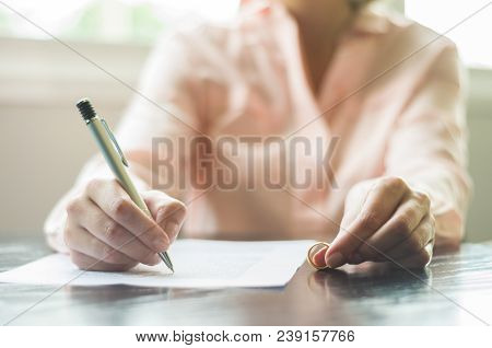 Great Concept Of Divorce, End Of Relationship, Young Woman Signing Divorce Agreement.