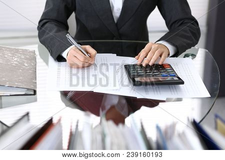 Female Bookkeeper Or Financial Inspector  Making Report, Calculating Or Checking Balance. Internal R