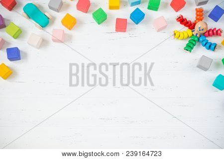 Kids Toys Frame Wooden Blocks, Octopus, Car On White Wooden Background. Top View. Flat Lay. Copy Spa