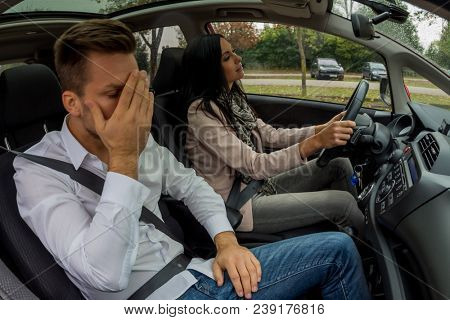 couple is driving in a car