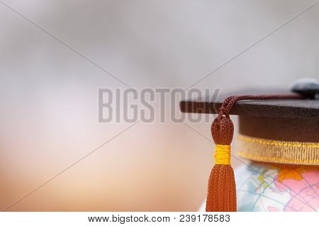 Graduate Study Abroad Concept, Graduation Cap On Top Earth Globe Model Map On Laptop Background. Gra