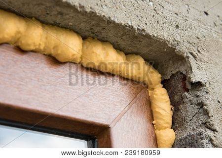 Diy Concept. Construction Pu Foam. The Window Is Installed Using A Mounting Foam. Installation Foam