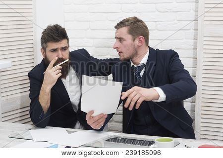 Business Partners, Businessmen Discuss Business At Meeting In Office. Bearded Boss Concentrated Thin