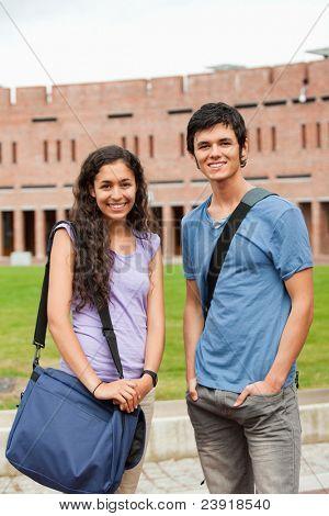 Portrait of classmates posing outside a building