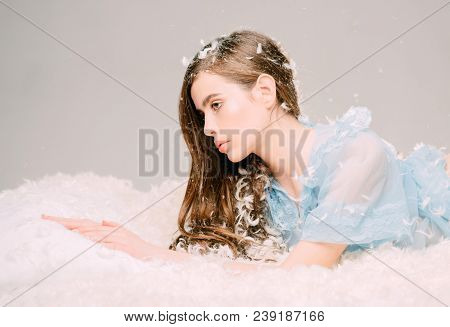 Woman With Long Hair In Tender Pajama Relaxing. Lady In Transparent Blue Nightie Lay On Bed, Grey Ba
