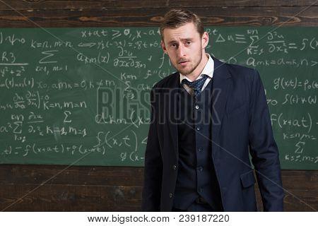 Intelligent Man In Suit Standing In Classroom. Aristocrats And Elite Concept.