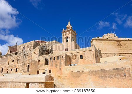 Victoria, Gozo, Malta - April 3, 2017 - View Of Part Of The Citadel And Cathedral Tower, Victoria (r