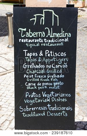 Silves, Portugal - June 10, 2017 - Traditional Portuguese Restaurant Menu Board In The Old Town, Sil