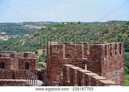 Silves, Portugal - June 10, 2017 - Medieval Battlements And One Of The Towers Inside The Castle With