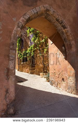 Street Of Medieval Village Of Roussillon. It Ochre Village Is Included In List Of