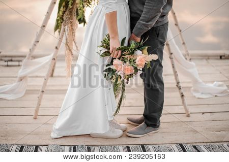Man And His Beautiful Fiance Standing On The Wedding Ceremony On The Beach On The Wooden Rostrum