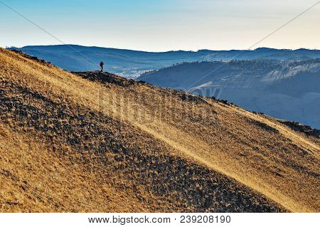 A Person In Red Jacket Standing Far On A Hill In A Steppe In Siberia In Spring At Sunset