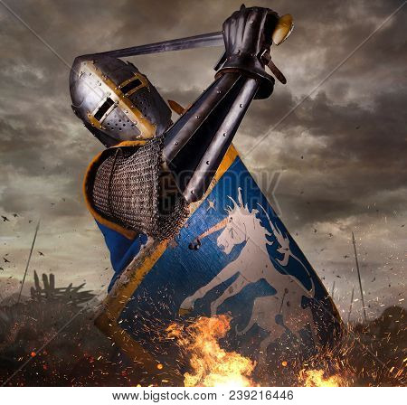 Knight In Battle Rise With Sword. Knight With Sword In Battlefield.