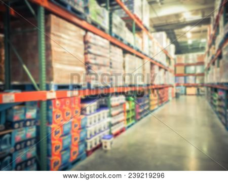 Blurred Aisle Of Laundry Detergent Products In Wholesale Store