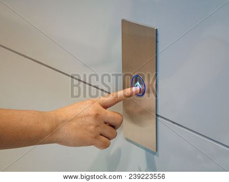 Finger Presses The Elevator Button,up And Down Button.woman Pressing Elevator Button. Finger Presses