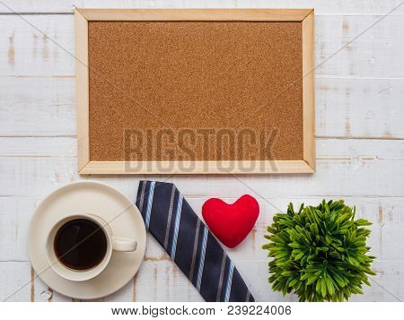 Happy Father's Day Inscription With Colorful Tie, Redheart, Plant And A Cup Of Coffee  On White Wood
