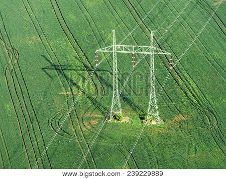 Mast Electrical Power Line In Field , Aerial View From Balloon On High Voltage Mast
