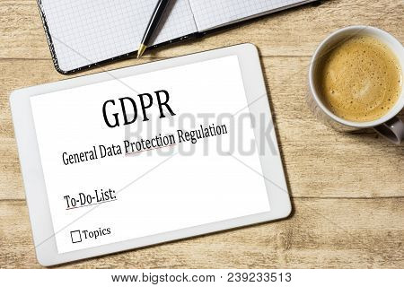 Tablet With Gdpr Document On Desk With Coffee