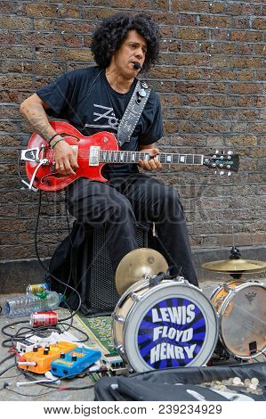 London, Great Britain, April 22, 2018 : Guitarist In Brick Lane. Recently The Area Has Broadened To