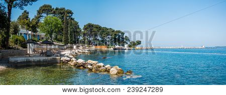 Beach And Resort With Beach Chairs In Morning Light On The Beach Of A Croatian Seaside Holiday Resor