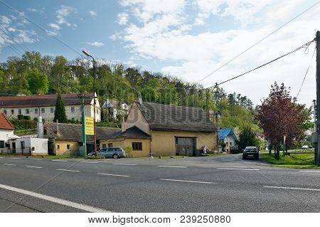 Zelizy, Czech Republic - April 26, 2018: Houses And Cars Near Route 9 In Spring Centre Of Zelizy Vil