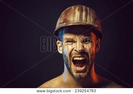 Portrait Of Screaming Bearded Handsome Builder, Closeup. Bearded Man With Protect Helmet Wearing. Bu