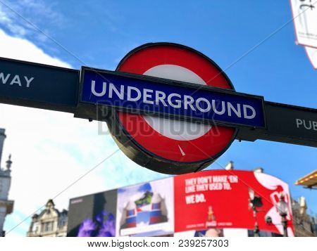 PICCADILLY CIRCUS, LONDON - MAY 3, 2018: Entrance sign above the street entrance to Piccadilly Circus Underground Station in central London, UK.