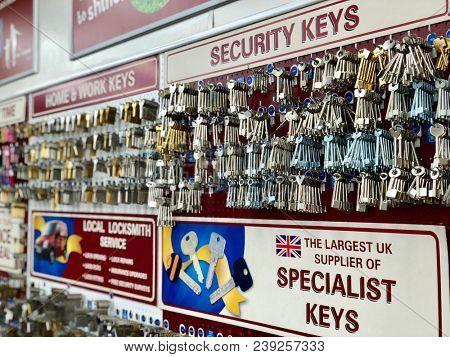 RICHMOND, LONDON - MAY 3, 2018: Blank keys ready to be cut at a key cutting ship in Richmond, West London, UK.