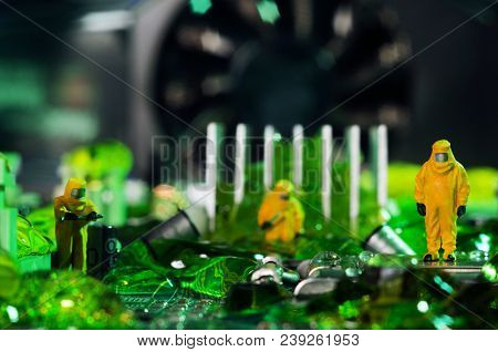 The Ecologists Or Technicians Cleaning Toxic Or Radioactive Waste On Motherboard.  Environment Pollu