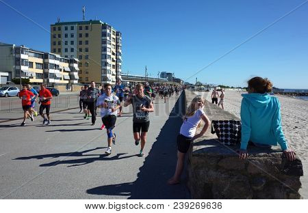 Helsingborg, Sweden - 05 May, 2018: People running competition along the shore of Oresund strait. IFK Helsingborg City Run Springtime performs the 38th edition