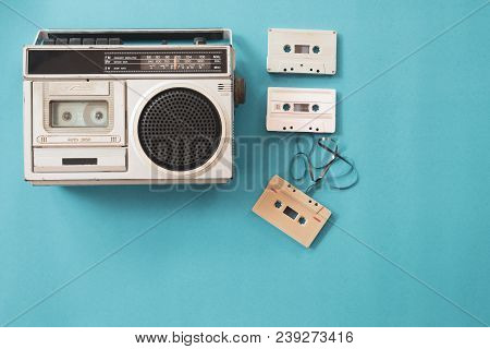 Vintage Radio And Cassette Player On Blue Background, Flat Lay, Top View. Retro Technology