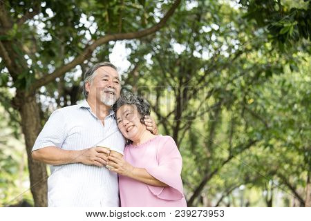 Asian Senior Couple Smiling Together At Outdoor Park. People Lifestyle Concept.