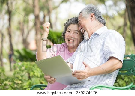 Elder People Using Laptop With Excited Emotion Together. People Lifestyle Concept.