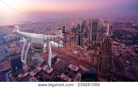 Multicopter Drone flying over the cityscape of Dubai, UAE