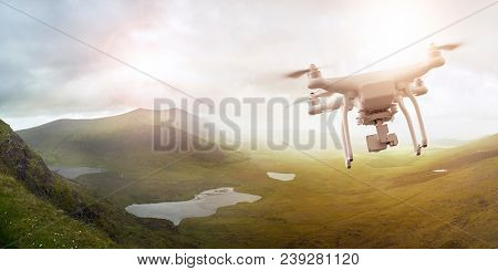 Multicopter drone flying over a scenic landscape in Ireland, Brandon Bay, Dingle peninsula, Co. Kerry, Ireland