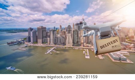 multicopter drone flying with package over the lower part of Manhatten, New York City, Manhattan