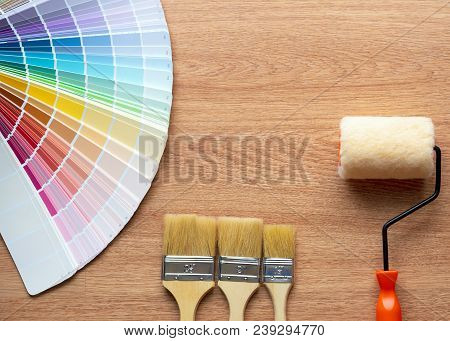 Painter And Decorator Work Table With House Project, Color Swatches, Painting Roller And Paint Brush
