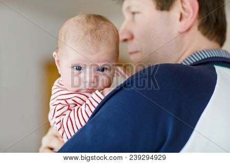Happy Proud Young Father Having Fun With Newborn Baby Daughter, Family Portrait Togehter. Dad With B