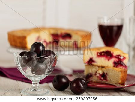 Homemade Plum Cake On A Glass Stand And Red Wine. Selective Focus.