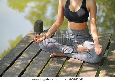 Woman Do Yoga Outdoor. Woman Exercising Vital And Meditation For Fitness Lifestyle Club At The Natur