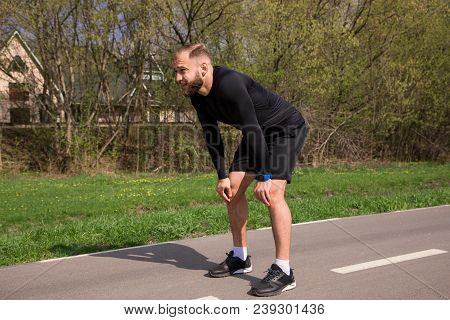 Deep Breathing After Running! Handsome Bearded Fit Young Man Tired A Little Bit And Breathing, While