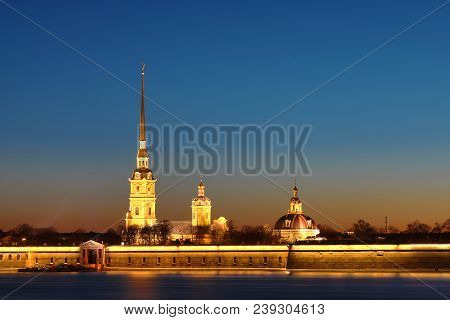Peter And Paul Fortress Of St. Petersburg, Russia In The Rays Of Setting Sun. The Peter And Paul For