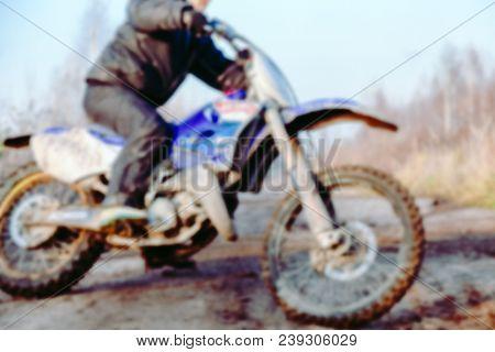 Blurred Motocross Racer Accelerating In Dirt Track On The Mountain Motocross Race In Dirt Track In D