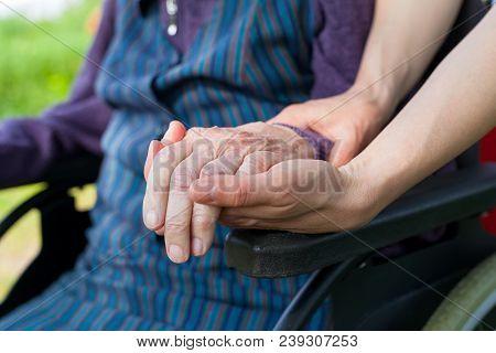 Holding Hands - Parkinson Disease