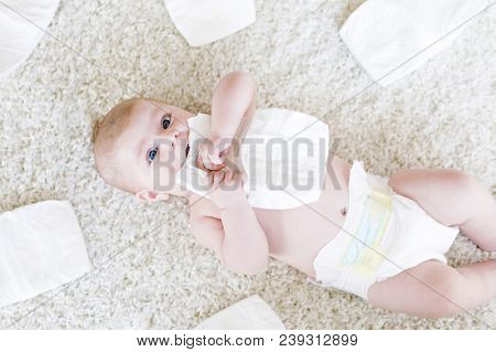 Cute Adorable Newborn Baby Of 3 Moths With Diapers. Hapy Tiny Little Girl Or Boy Looking At The Came