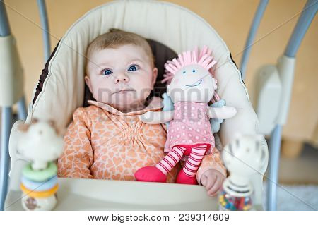 Cute Adorable Newborn Baby Sitting In Swing. Closeup Of Peaceful Child, Little Baby Girl Swinging An
