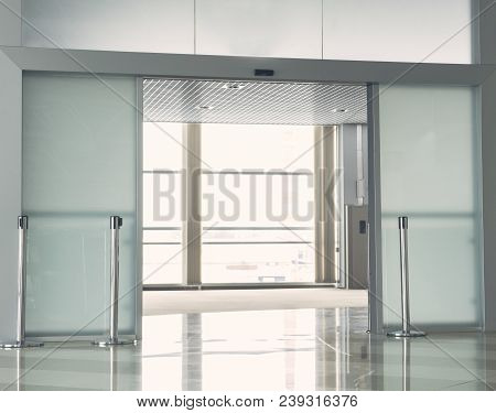 Wide Bright Modern Office With Opened Glass Door And Wide Windows