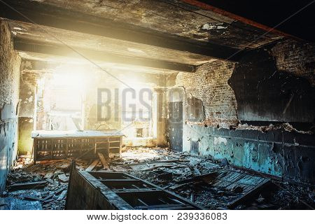 Ruins Of Old Abandoned Building, Damaged In War, Inside Destroyed Room With Sunlight, Disaster And D