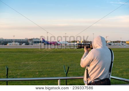 Gdansk, Poland - May 5, 2018: Plane Spotter Taking A Photo Of An Airplane Landing At Lech Walesa Air